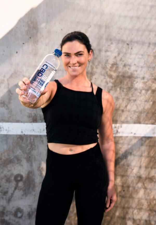 Girl holding CBD Living Water
